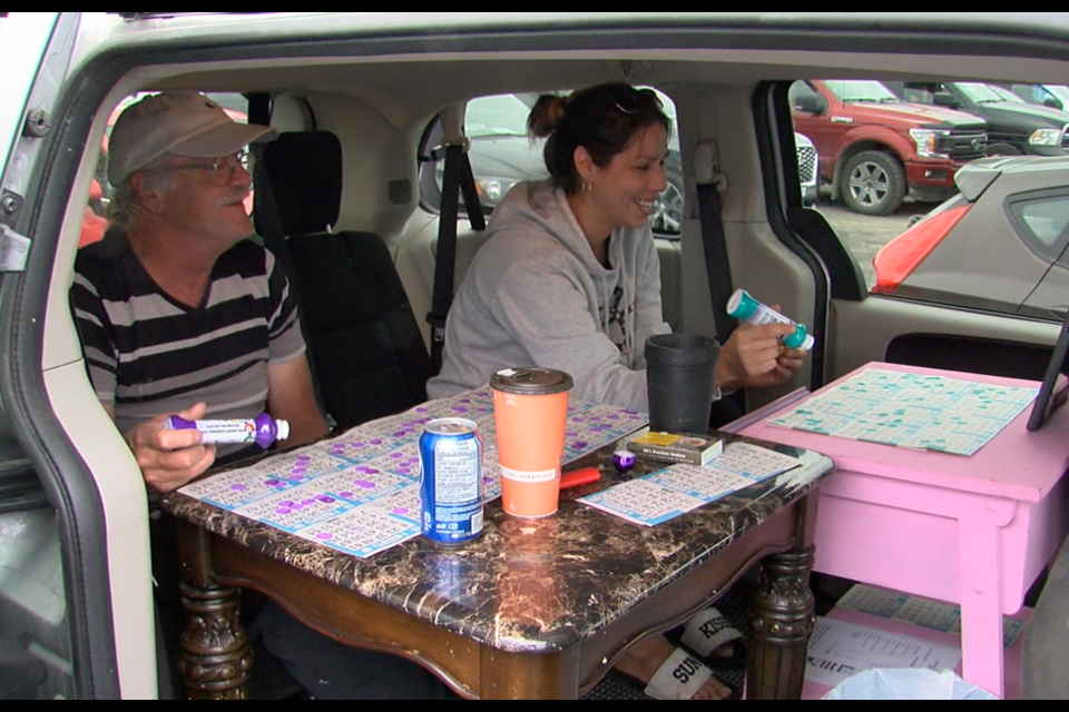 Two bingo players had a comfortable set-up in their van for opening night of drive-in bingo on the Fort William First Nation (Jonathan Wilson/TBTV photo)