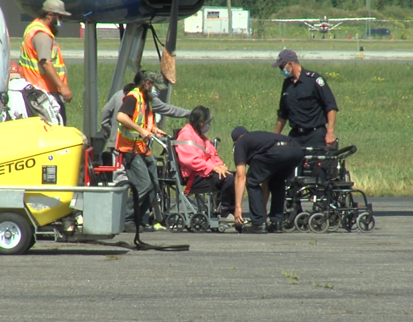 Thunder Bay firefighters assisted evacuees from Eabametoong First Nation who arrived in the city on Aug. 12, 2020 (Cory Nordstrom/TBTV photo)