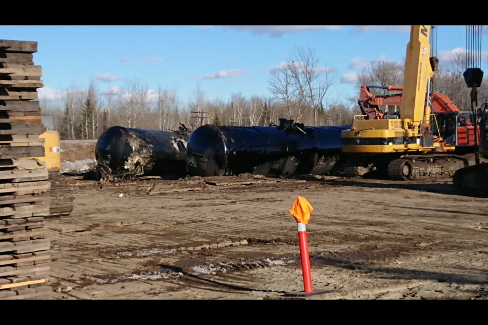 Some damaged tank cars have been moved to a temporary storage site near the derailment site east of Emo (Adam Riley/TBTV)