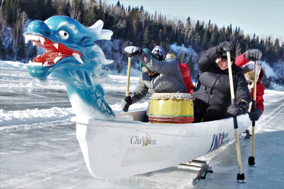 Staff at Fort William Historical Park demonstrate ice dragon boat racing, one of the many activities offered at the Voyageur Winter Carnival. (Photos by Ian Kaufman, tbnewswatch.com)