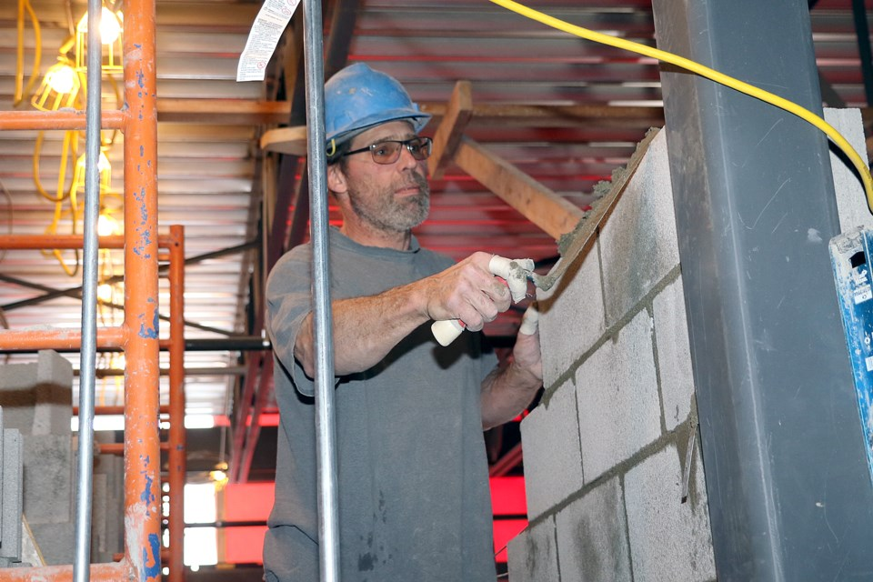 A worker does masonry work on Friday, Jan. 24, 2020 at Ecole Elsie MacGill Public School. (Leith Dunick, tbnewswatch.com)