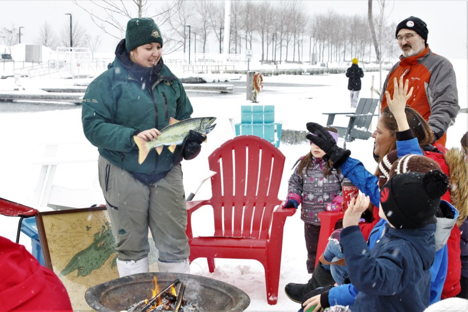 Parks Canada interpreter Sarah Rauh shares stories about Lake Superior with families at this Sunday's Winter FunDays event (Ian Kaufman, Tbnewswatch)