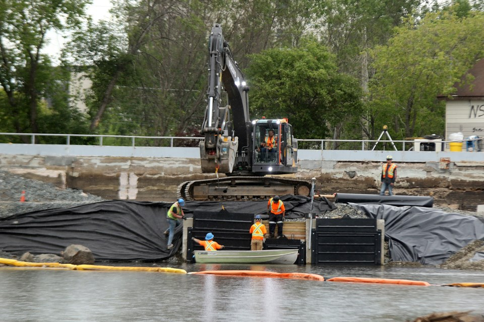 Repairs are made to the Boulevard Lake dam on Tuesday, July 21, 2020. (Leith Dunick, tbnewswatch.com)
