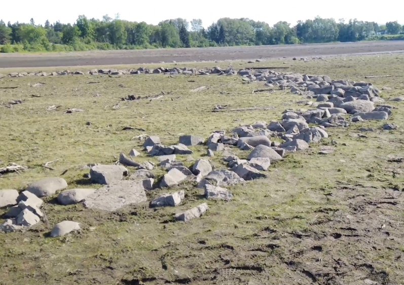The draining of Boulevard Lake has exposed the rocks that make up a mysterious circle on the lake bed (Facebook/Lakehead Univ./CARIS