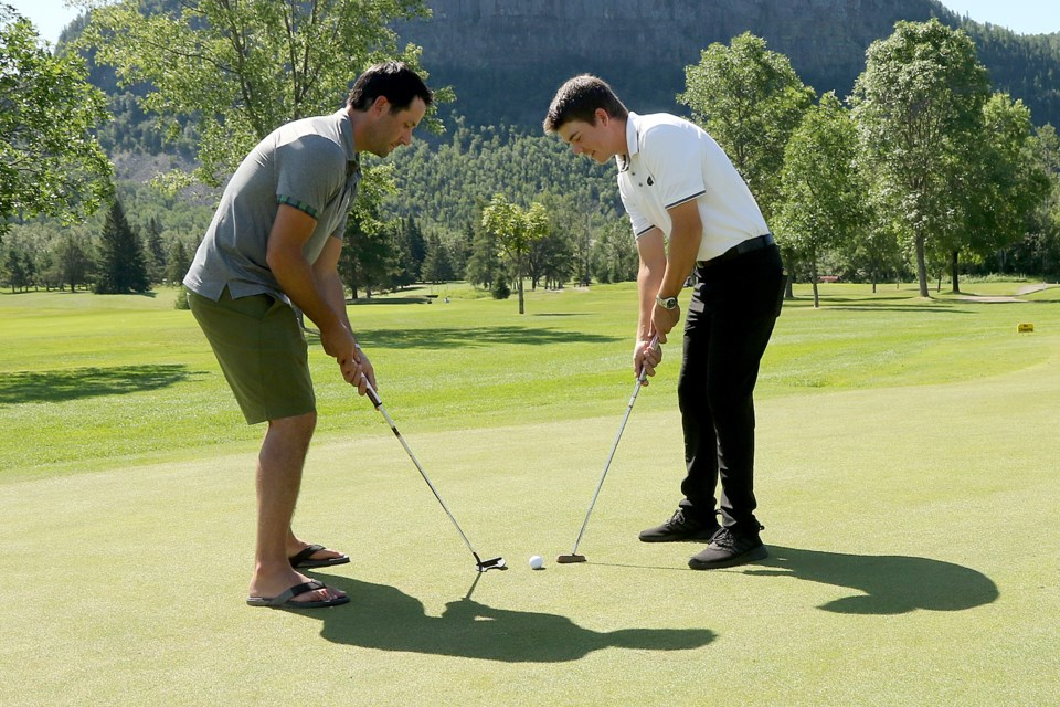 Carter Hutton (left) and Evan DeGrazia plan to face off for real at Fort William Country Club on Thursday, Aug. 6, 2020 in a revamped version of the annual Hometown Hereos golf tournament in support of the George Jeffrey Children's Foundation. (Leith Dunick, tbnewswatch.com)
