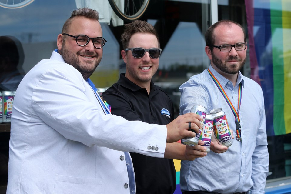 Kevin Brewer (centre), general manager at Sleeping Giant Brewery, on Wednesday, June 24, 2020 is joined by Thunder Pride chair Jason Veltri (left) and Borderland Pride co-chair Douglas Judson to launch Pride Lives Here beer. (Leith Dunick, tbnewswatch.com)