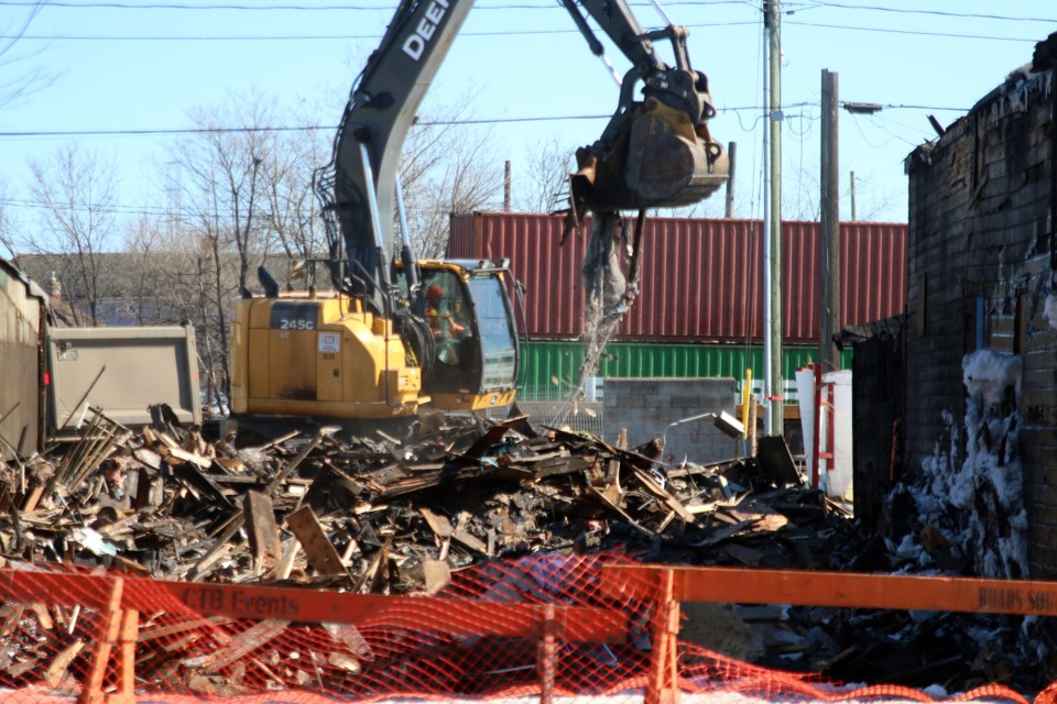 Rizzo's Cabinets on Simpson Street was being torn down on Thursday.