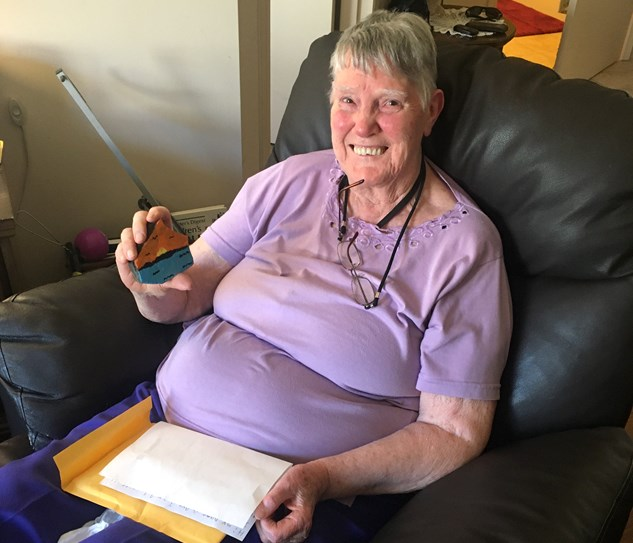 Mrs.Harriet Renaud, a resident at Chartwell Thunder Bay, holds up a painted rock by a student at McKenzie Public School. Reneaud is also a former teacher at McKenzie. (Photo supplied).