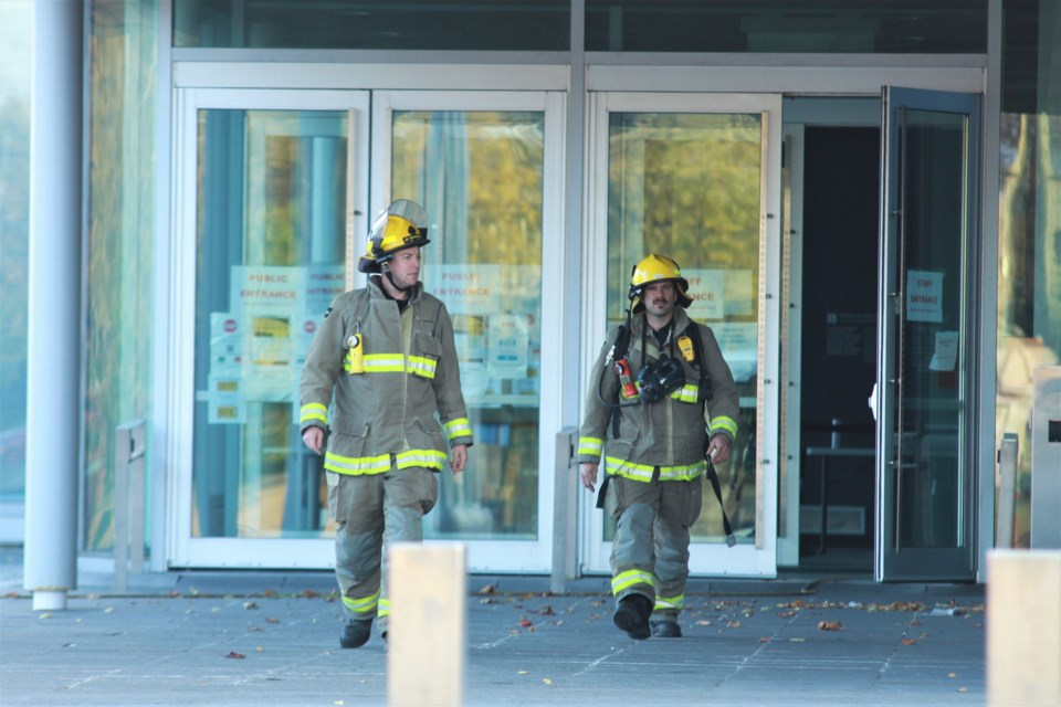Firefighters emerge from the Thunder Bay Courthouse Sunday evening (Photos by Ian Kaufman, tbnewswatch.com)