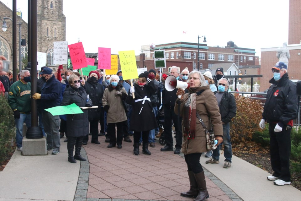 More than 100 people gathered outside Thunder Bay City Hall to demand answers on the issue of pinhole leaks in copper water pipes. (Photos by Doug Diaczuk - Tbnewswatch.com).