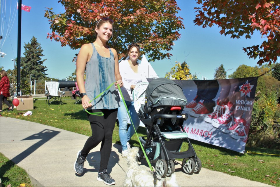 Nikki Stein, left, walks in the Multiple Myeloma March with Allison McLellan and her son Liam Sunday. (Ian Kaufman, tbnewswatch.com)