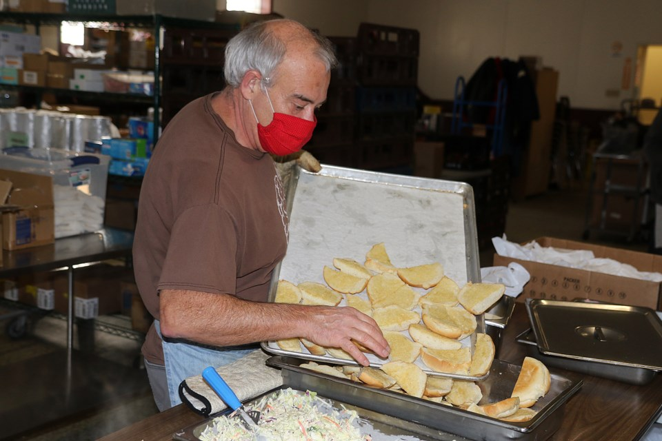 Volunteers help prepare and serve up food for up to 300 people each day at the Dew Drop Inn, wihch turns 40 in 2021. (Leith Dunick, tbnewswatch.com)