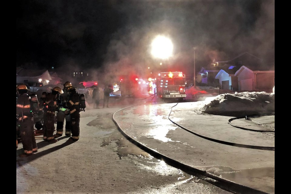 Firefighters respond to a blaze that destroyed a Dryden home and several vehicles Friday. (Dryden Fire Service)