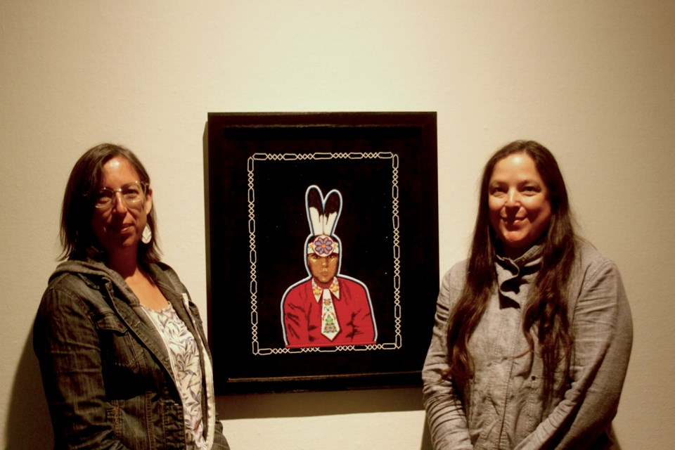 Leanna and Jean Marshall stand with a beaded portrait of  the late Jesse Gustafson (Justin Hardy/tbnewswatch.com)