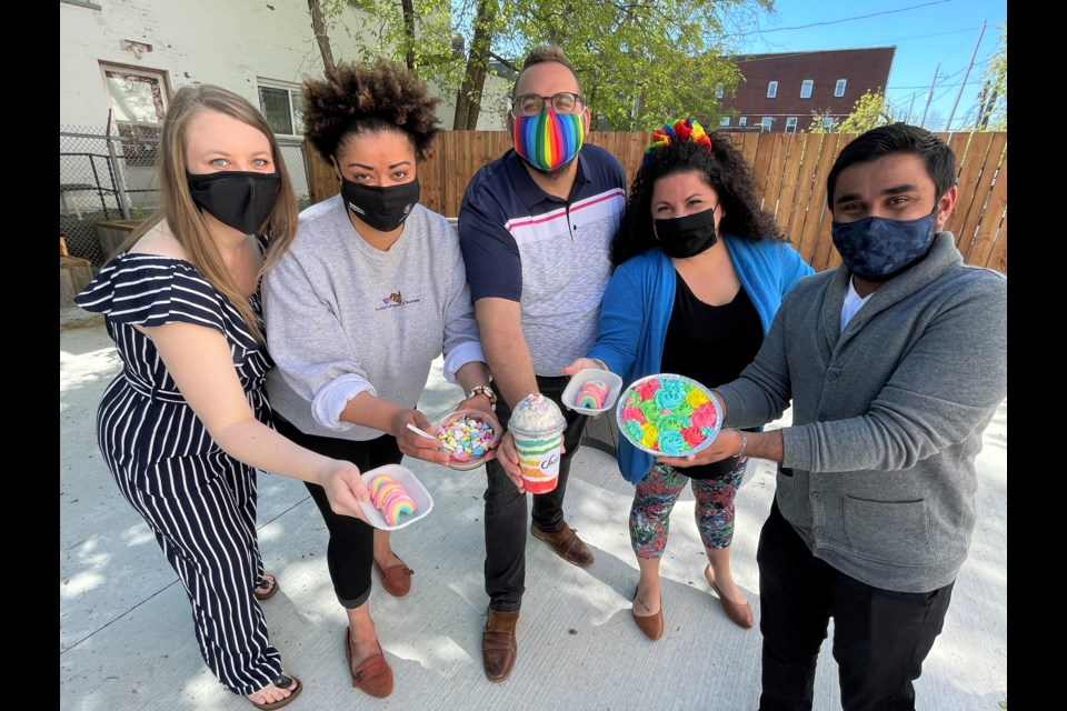 Erikka Mikkola, Colleen Peters, Jason Veltri, Annalicia Kaban, and Vignesh Viswanathan show off some of the sweets being sold for a good cause as part of Dessert Days. (Submitted photo)