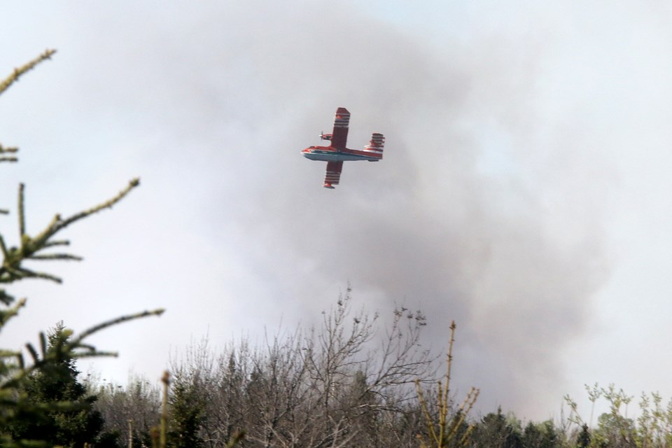 A water bomber from Newfoundland & Labrador flies over  Thunder Bay Fire No. 8, near Sarri Road, on Tuesday, May 18, 2021. (Leith Dunick, tbnewswatch.com)
