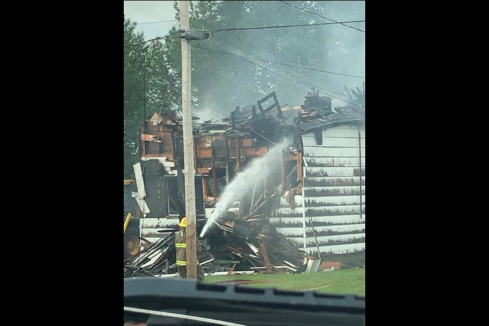Firefighters douse a burning house in Nipigon on Jun. 20, 2021  (Facebook/Todd Childs)