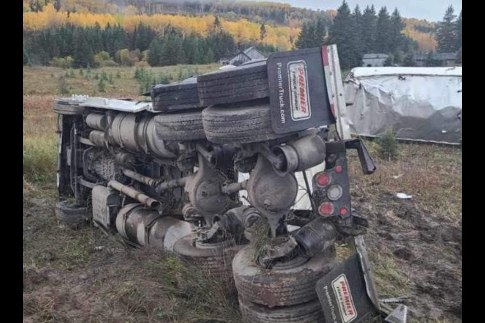 A tractor-trailer overturned after blowing past a stop sign at Sistonen's Corner, west of Thunder Bay, on Oct. 2, 2021 (Facebook/Skilled Truckers Canada)
