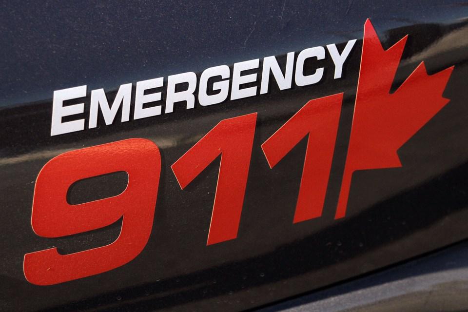 911 logo on car