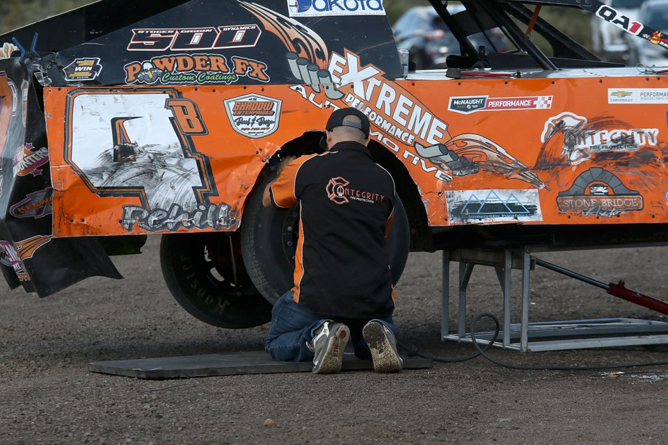 Crews get their race cars ready for the 2021 Thunder Bay Truck Centre Dirt Track Nationals at the Dairy Queen International Speedway on Highway 130. (Leith Dunick, tbnewswatch.com)