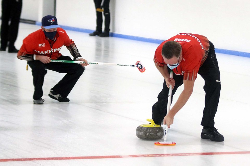 Skip Ben Mikkelsen (left) watches his shot on Wednesday, Dec. 2, 2020 at the Kakabeka Falls Curling Club. (Leith Dunick, tbnewswtdh.com