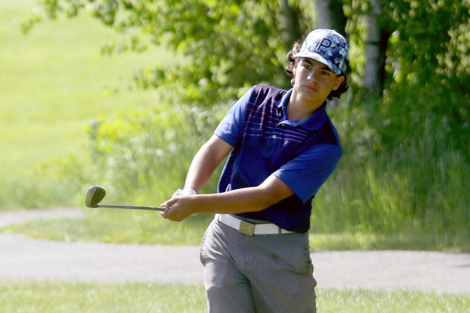 Nathan LePore chips from behind the 16th green at Whitewater Golf Course on Sunday, June 6, 2021. (Leith Dunick, tbnewswatch.com)