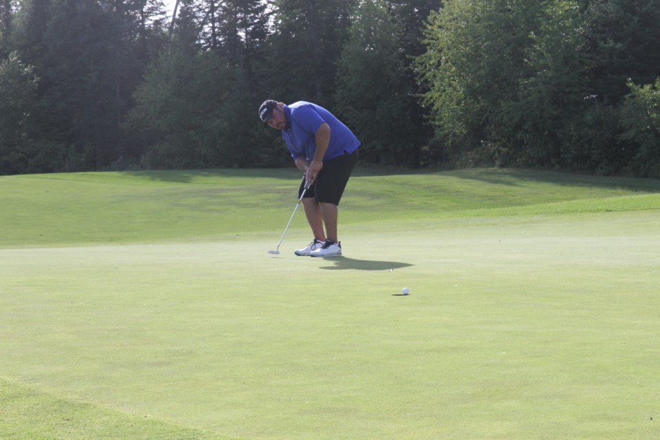 Colin Sobey had his championship putt hand on the edge of the cup...