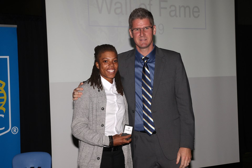 Jylisa Williams accepts her Lakehead Unviersity Wall of Fame ring from women's basketball coach Jon Kreiner on Saturday, Oct. 5, 2019. (Leith Dunick, tbnewswatch.com)