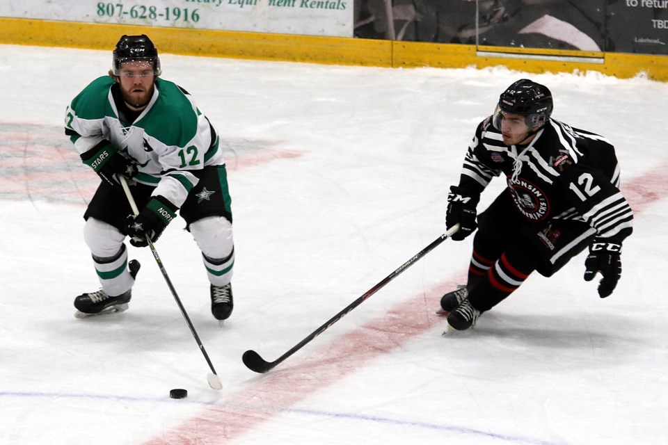 Thunder Bay's Logan Mihalcin (left) and Wisconsin's Tyler Shetland chase down the puck on Wednesday, Oct. 16, 2019. (Leith Dunick, tbnewswatch.com)
