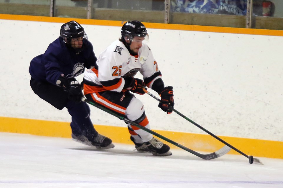 Kam River's Zach Fortin (right) pulls away from a Lakehead Junior Hockey League All-Star defender on Saturday, Sept. 11, 2021 at the NorWest Arena. (Leith Dunick, tbnewswatch.com)