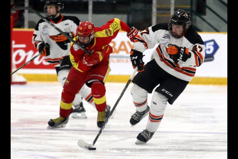 Magog's Alexandre Doucet (right) and Halifax's Ian Watt each scored on Tuesday, April 23, 2019 at the TELUS Cup at Fort William Gardens. (Leith Dunick, tbnewswatch.com)