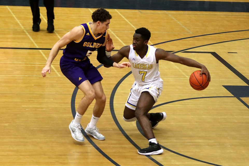 Lakehead;s Laoui Msambya (right) battles Laurier's Jackson Mayers on Saturday, Feb. 22, 2020. (Leith Dunick, tbnewswatch.com)
