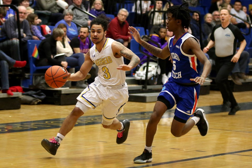 Lakehead's Alston Harris (left) looks for a way to drive past UOIT's A.J. Cummings on Friday, Feb. 14, 2020. (Leith Dunick, tbnewswatch.com)