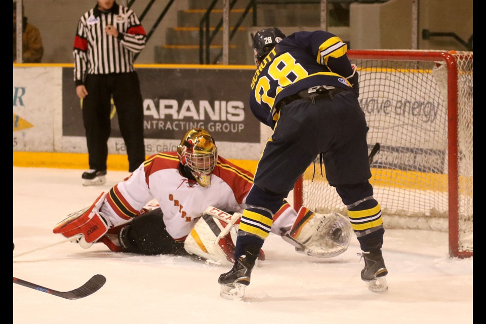 Guelph goalie Jason Da Silva robs Lakehead forward Sam Schutt on Friday, Dec. 29, 2017 at Fort WIlliam Gardens. (Leith Dunick, tbnewswatch.com)
