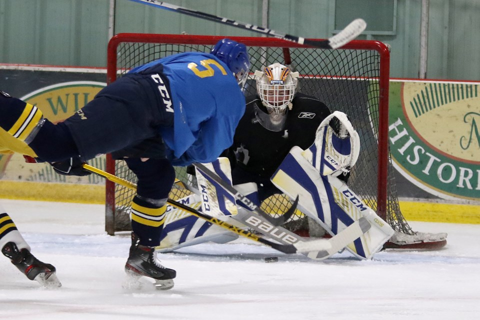 Ben Badalamenti slides the puck through the five-hole of Lakehead goaltender Blake Weyrick during a scrimmage on Monday, Sept. 13, 2021 at the Tournament Centre. (Leith Dunick, tbnewswatch.com)