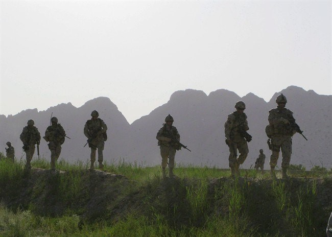 Canadian soldiers patrol an area in the Dand district of southern Afghanistan on Sunday, June 7, 2009. (Colin Perkel, The Canadian Press)