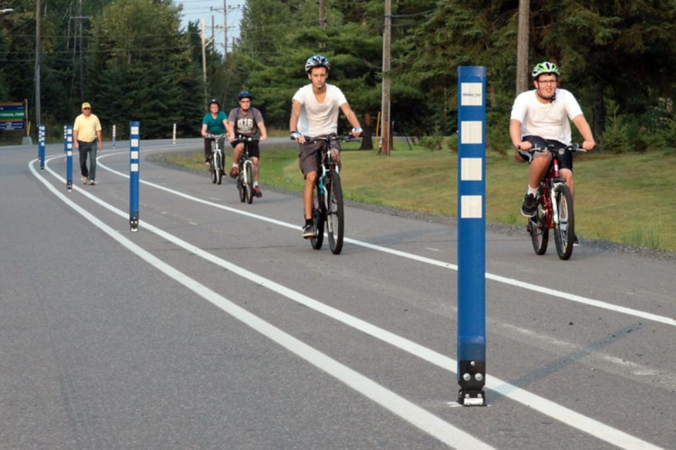 Cyclists and pedestrians enjoy a multi-use trail along Arundel Street. (File photo)