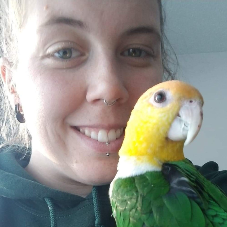 rtam bursary recipient cassie palidwor and her pet bird fiona