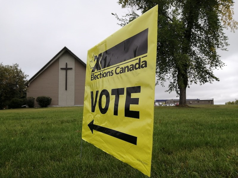 sept 20 2021 election sign thompson manitoba luthern united church caribou road