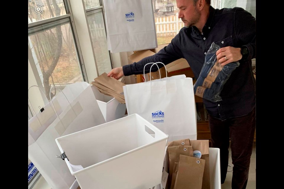 Brandon, a Socks for Change board member, prepares sock packages for delivery to people who ordered them from across Niagara. Submitted Photo