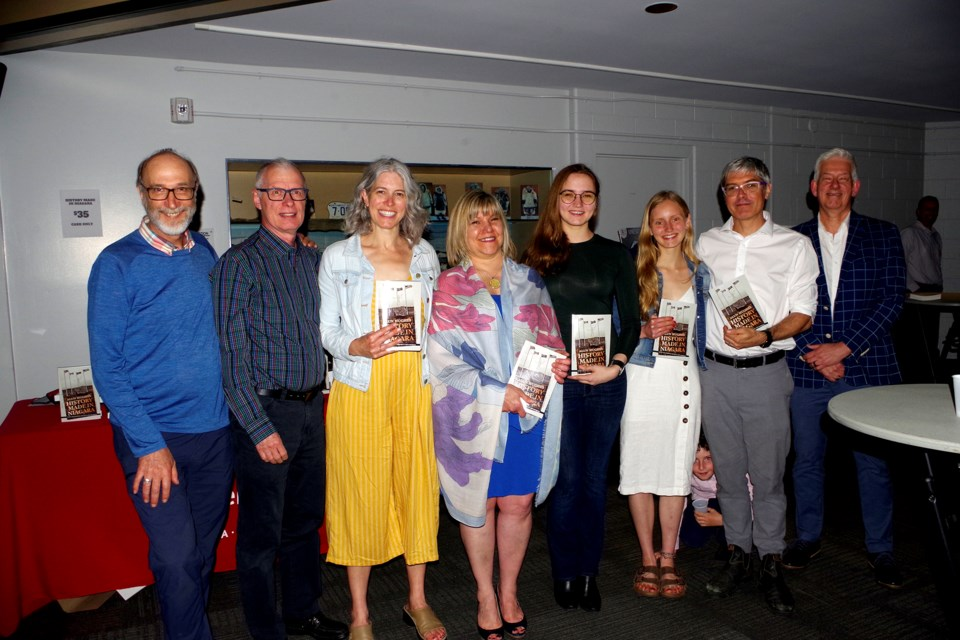 David Butz, Loris Gasparotto, Elinor Hughes Matheson, Joyce Little, Nia Hughes, Ffion Hughes, Dafydd Hughes, and Mike Ripmeester celebrated the publication of Alun Hughes' book. Bob Liddycoat / Thorold News