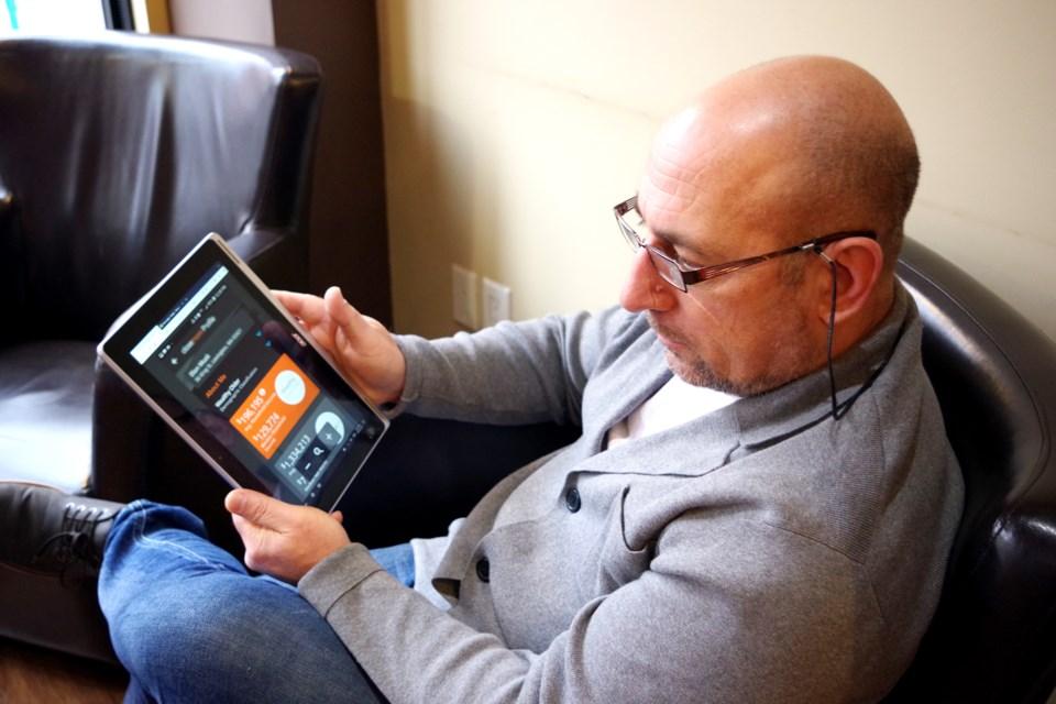 Thorold entrepreneur Jim Kalogerakos demonstrates the Closemore app. Bob Liddycoat . Thorold News
