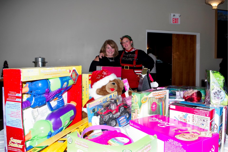 Nancy Waters (l) and Amanda Ettinger, with table full of toys for kids at Christmas. Bob Liddycoat / Thorold News
