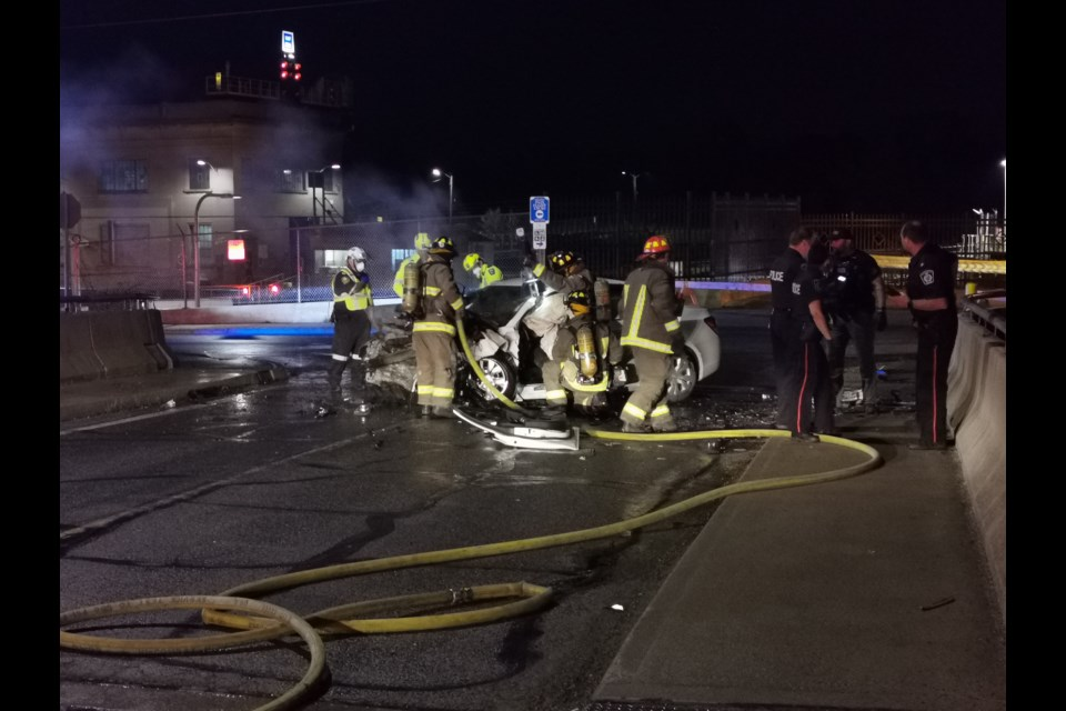 Crews working on the scene of the incident. Photo: Justin Forster/Supplied