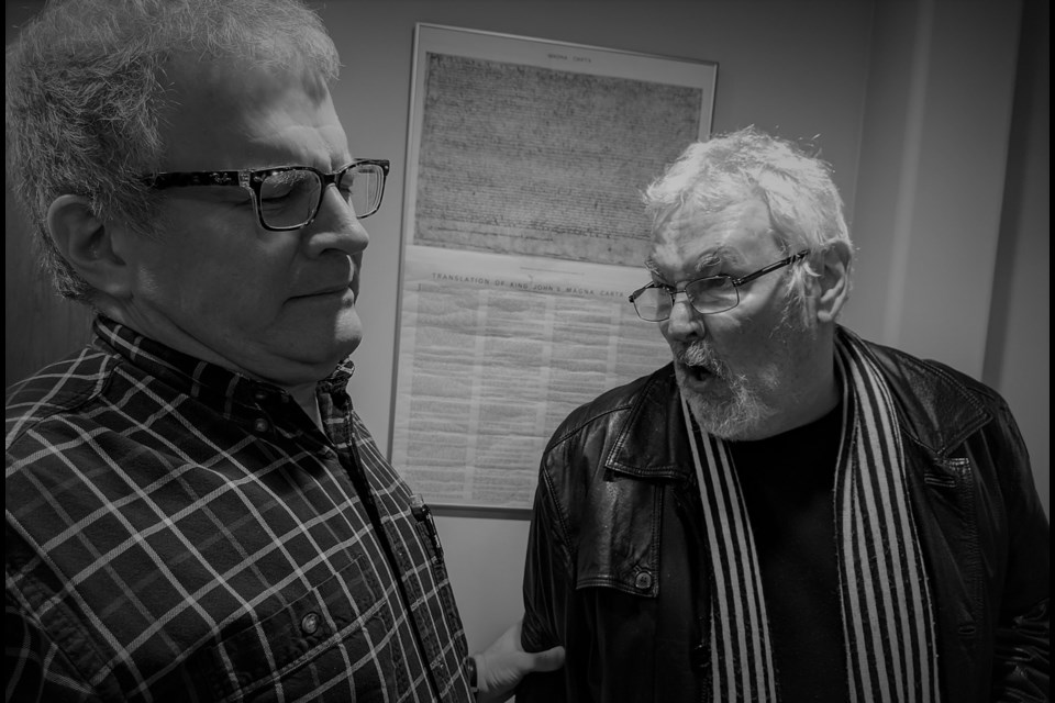 A tense moment is being rehearsed between Robert Laszcz and Peter Churey. Photo: Supplied