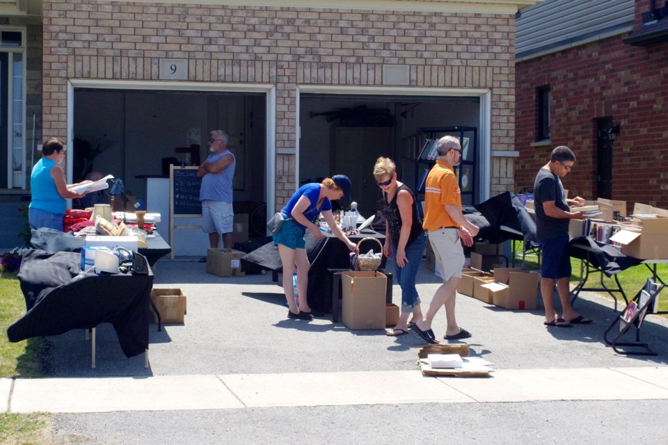 Rolling Meadows resident and organizer Carol Ford and her neighbours saw a steady flow of shoppers attending the Thorold South community's 2nd annual multi-yard sale Saturday. Bob Liddycoat / Thorold News