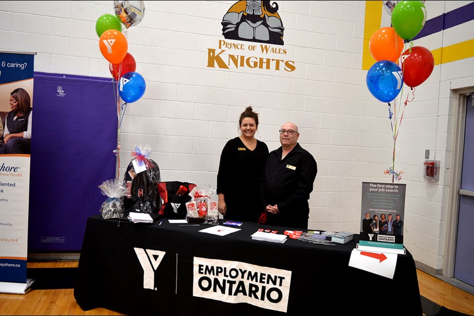 Hope Townson, Coordinator of the YMCA Employment Ontario, and Rick Boutin, Employment Coach of the Thorold office manning the customer service booth, registering people for door prizes and taking surveys on how to improve their job fair experience. Gloria Katch / Thorold News