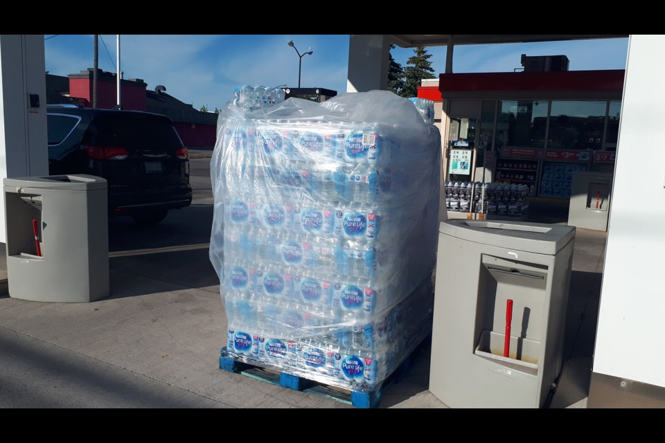 A skid of water stored under the blazing sun at a Niagara gas station. Bob Liddycoat / Thorold News
