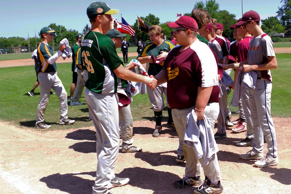 Kids from Thorold (green shirts) exchanged hats and t-shirts with North East, Pennsylvania players (maroon shirts) Bob Liddycoat / Thorold News