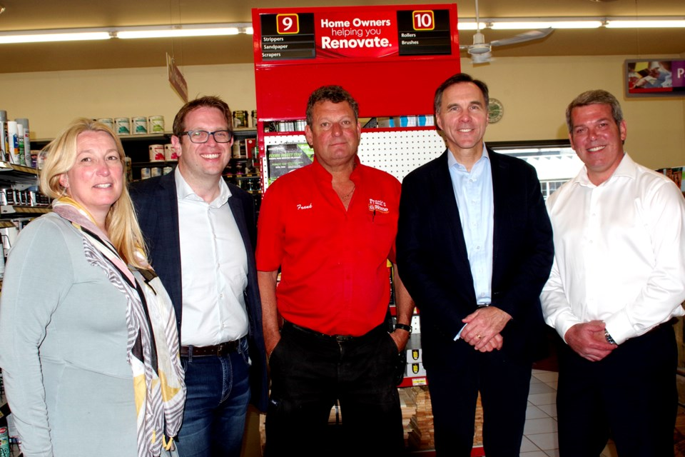 Niagara Liberal candidates joined Toronto candidate, and Finance Minister Bill Morneau in bringing a federal initiative home to Niagara. Pictured (l-r) Niagara Falls candidate Andrea Kaiser, St. Catharines candidate Chris Bittle, Home Hardware owner Frank Danch, Morneau, and Vance Badawey, Niagara Centre candidate. Bob Liddycoat / Thorold News